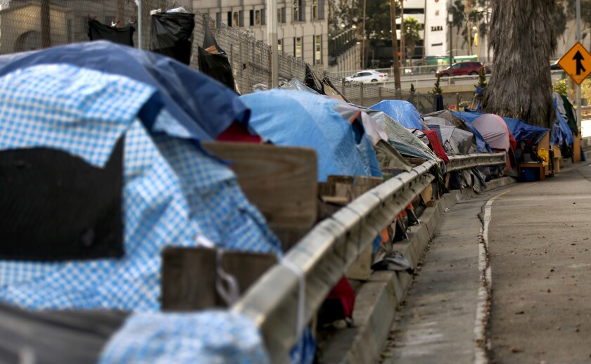 Tents line up along South Beaudry Ave. in Los Angeles, CA in the evening November 7, 2017.