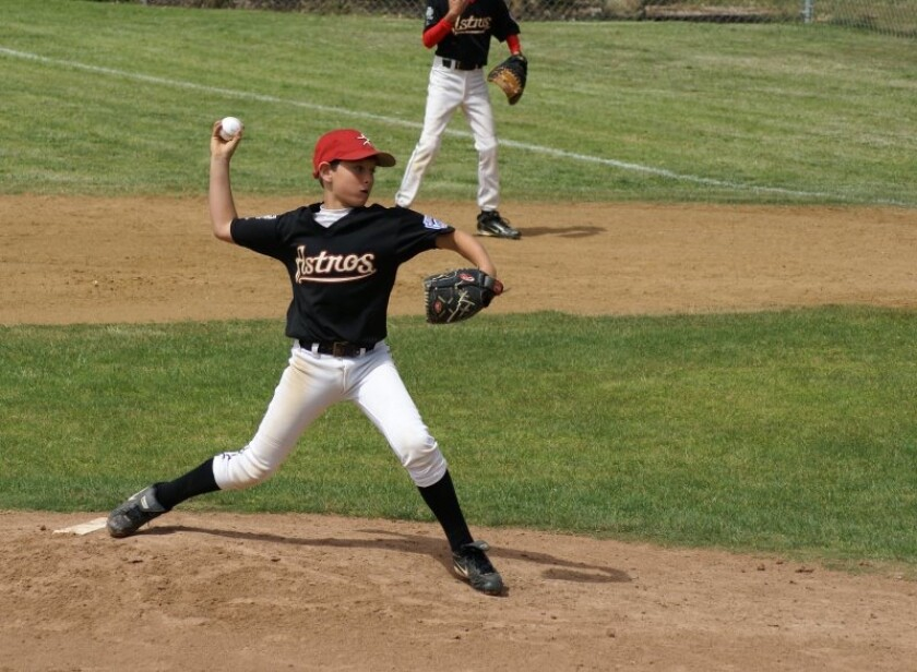 A young CJ Stubbs on the baseball field.