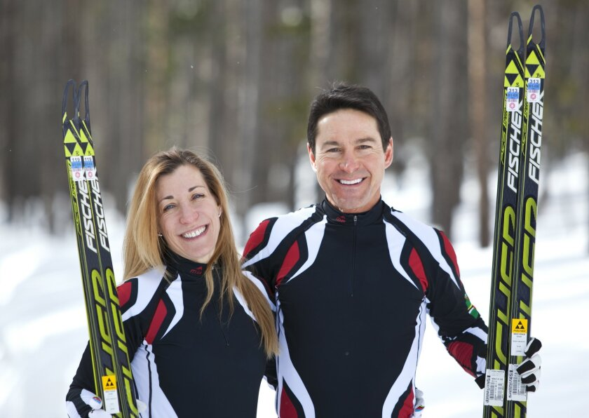 In this photo taken on Monday, Jan. 27, 2014, cross-country skiers Gary and Angelica di Silvestri pose for a photo at the Yellowstone Club in Big Sky, Mont. The American-born man and his Italian-born wife will be representing the tiny Caribbean island nation of Dominica at the Winter Olympics in So
