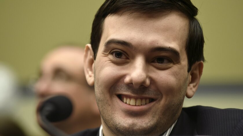 FILE - In this Feb. 4, 2016 file photo, Pharmaceutical chief Martin Shkreli smiles on Capitol Hill in Washington during the House Committee on Oversight and Reform Committee hearing on his former company's decision to raise the price of a lifesaving medicine.  Former pharmaceutical CEO and governme