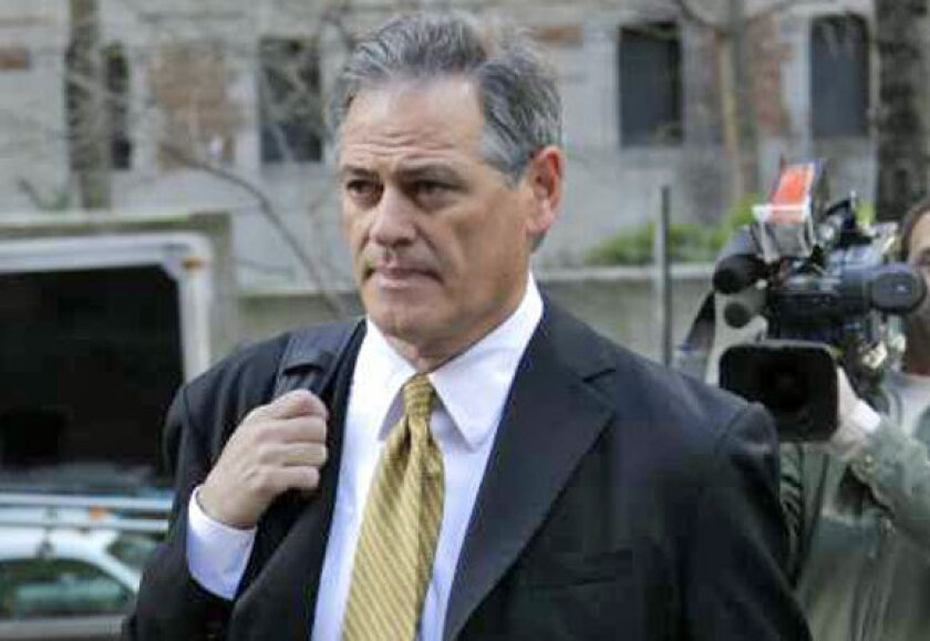 New Orleans Saints General Manager Mickey Loomis arrives for a meeting at NFL headquarters in New York on April 5.