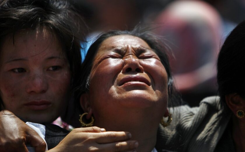 Relatives mourn the Sherpa guides who died on Mt. Everest