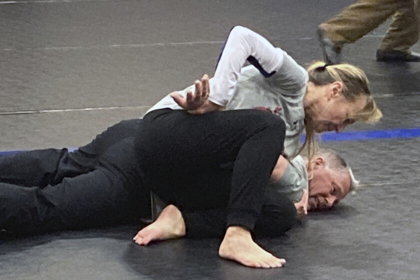 Eve Steffans of the Martial Arts Academy in Billings, Montana, practices judo techniques on Ed Thompson, a retired police officer, during a training session, March 9, 2021, in Douglas, Wyoming. USA Judo is holding workshops with police departments across the country to introduce them to judo techniques that could lessen the need for deadly force when officers have to apprehend people on the streets. (AP Photo/Eddie Pells)