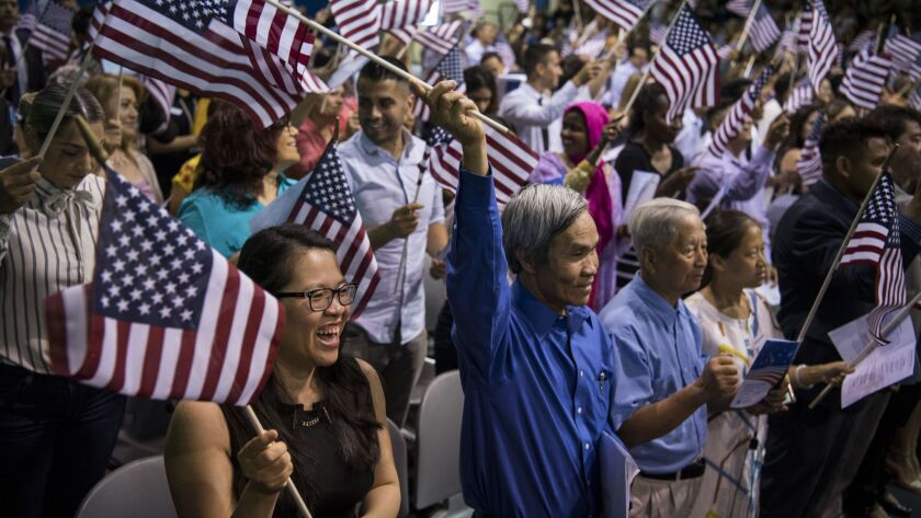 Ngoc Phuong T Pham, originally from Vietnam, participates in the Fiesta of Independence Naturalization Ceremony at South Mountain Community College in Phoenix, Ariz. on July 4.