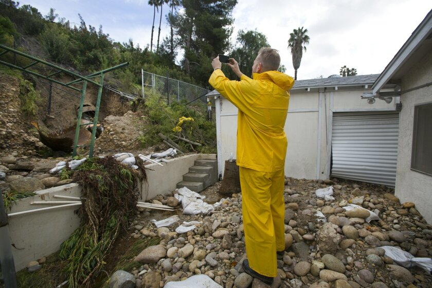 Guy Lawyer takes photos of the large broken storm drain water pipe that  broke in a hill in the backyard of his mom's home on Cabaret Street in San Carlos, flooding it and several others.