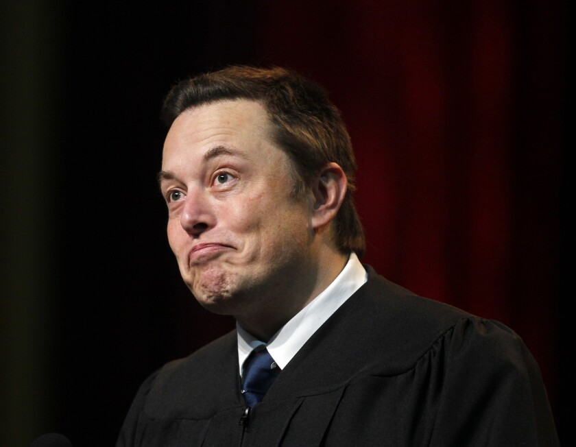 Tesla Motors Chief Executive Elon Musk, shown giving the commencement address at USC's Marshall School of Business on May 16, told shareholders that 2014 has been a great year and next year will be even better.