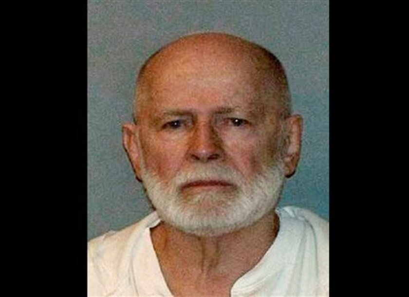 "FILE - This June 23, 2011 booking photo provided by the U.S. Marshals Service shows James ""Whitey"" Bulger, who fled Boston in 1994 and wasn't captured until 2011 in Santa Monica, Calif., after 16 years on the run. Lawyers for James ""Whitey"" Bulger acknowledged he ran a lucrative criminal enterprise that took in millions through illegal gambling, extortion and drug trafficking. On Friday, July 26, 2013, when the judge asked attorney J.W. Carney Jr. if Bulger might testify, he said only that he wo"