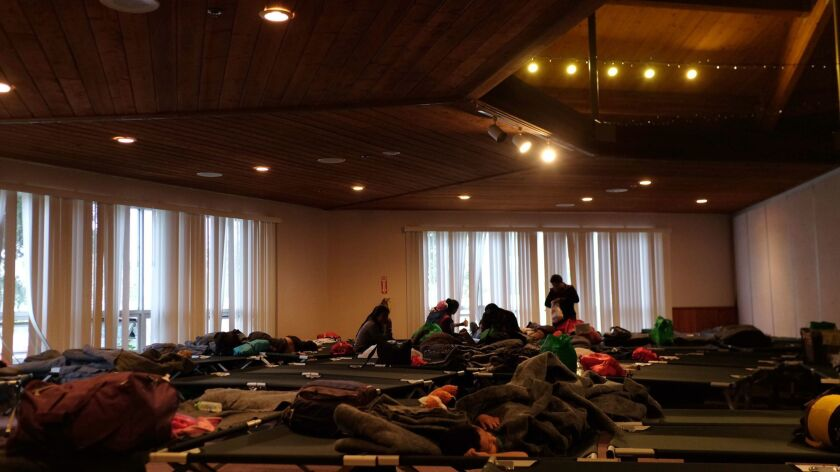 November 19, 2018_|Folding cots fill a room at the shelter.|A temporary migrant shelter opened since