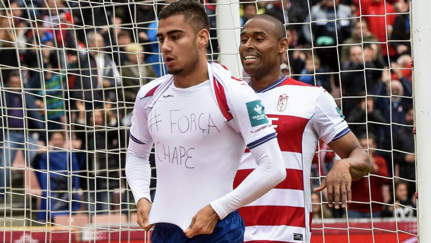 Granada midfielder Andreas Pereira celebrates after scoring a goal against Sevilla in a Spanish league game on Saturday by lifting his jersey to show a message of solidarity with the Chapecoense team.