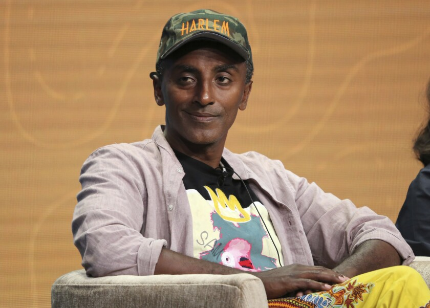 """FILE - Host/chef Marcus Samuelsson participates in PBS's """"No Passport Required"""" and """"South By Somewhere"""" panel at the Television Critics Association Summer Press Tour in Beverly Hills, Calif. on July 30, 2019. Samuelsson is hoping to educate Americans and champion Black chefs in """"The Rise: Black Cooks and the Soul of American Food"""" from Little, Brown and Company's Voracious imprint. The book has 150 recipes from two dozen top Black chefs and includes profiles of each. (Photo by Willy Sanjuan/Invision/AP, File)"""