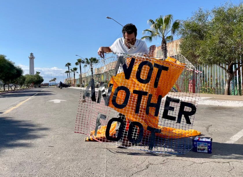 Daniel Watman, member of the Friends of Friendship Park Coalition holds a kite.