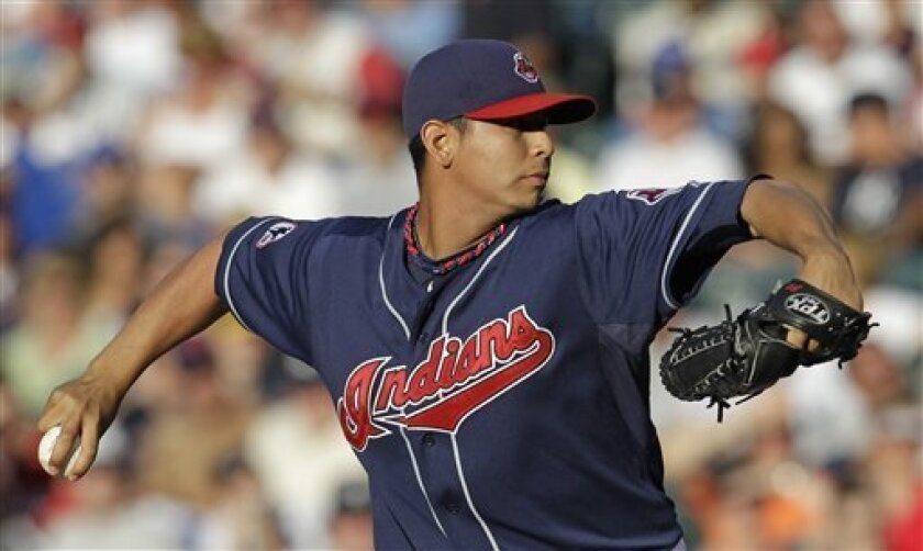 Cleveland Indians starter Carlos Carrasco pitches against the New York Yankees in the second inning in a baseball game, Tuesday, July 5, 2011, in Cleveland. (AP Photo/Tony Dejak)