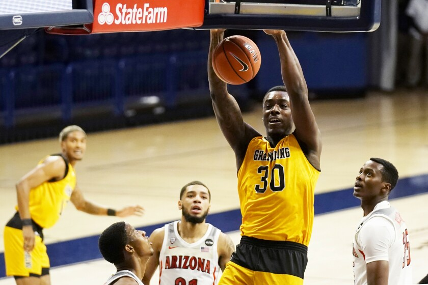 Grambling forward Brian Thomas (30) dunks against Arizona during the first half of an NCAA college basketball game Friday, Nov. 27, 2020, in Tucson, Ariz. (AP Photo/Rick Scuteri)