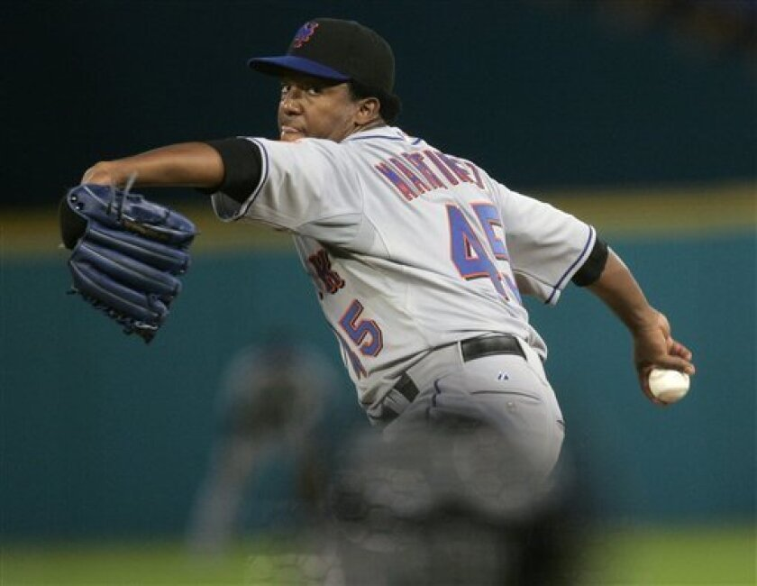 New York Mets' Pedro Martinez pitches in the second inning of a Tuesday, April 1, 2008, baseball game against the Florida Marlins in Miami. Martinez left the game in the fourth inning with an injury. (AP Photo/J. Pat Carter)