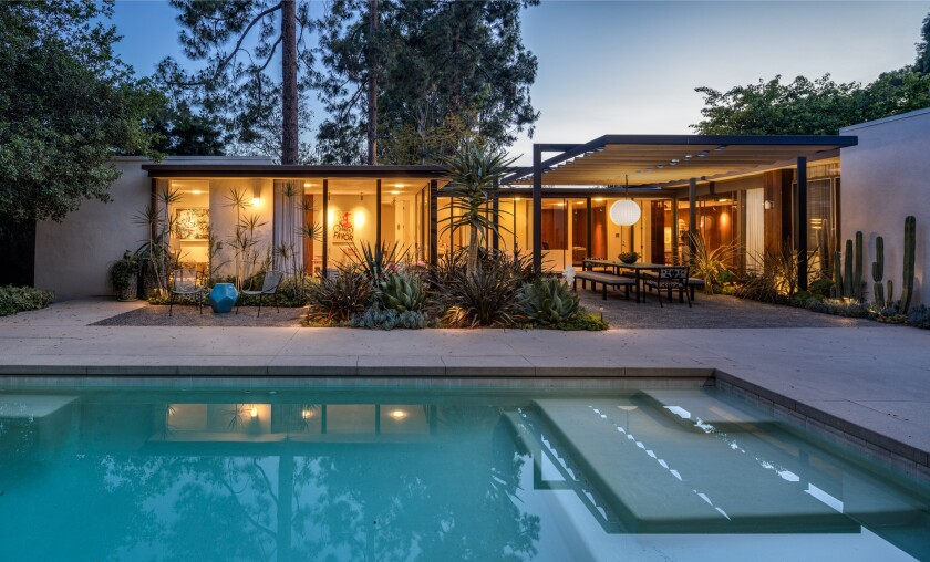 Built in 1961, the single-story home features Midcentury charms such as a courtyard entry and sky-lit hallways.