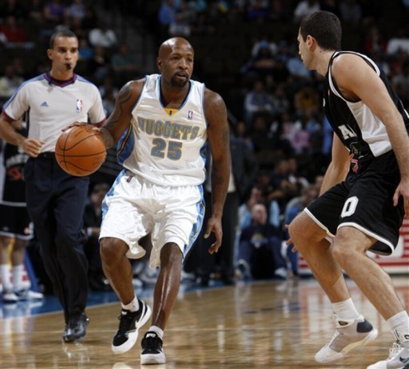 Denver Nuggets guard Anthony Carter, left, works the ball inside against Partizan Belgrade guard Aleksandar Rasic in the first quarter of an exhibition basketball game in Denver on Saturday, Oct. 3, 2009. (AP Photo/David Zalubowski)