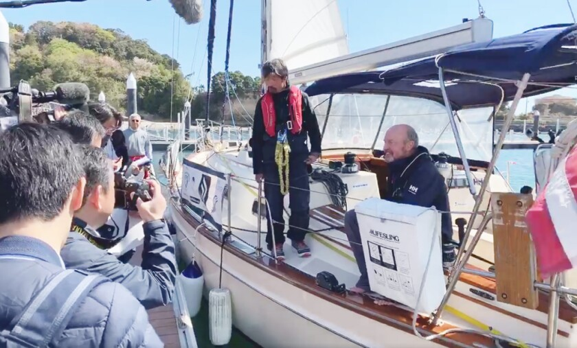 """San Diego resident Mitsuhiro """"Hiro"""" Iwamoto, 52, left, and sailing partner Doug Smith, 55, talk to reporters in Fukushima Harbor in Japan on Saturday after arriving from a 55-day nonstop voyage from San Diego aboard Smith's sailing yacht Dream Weaver."""