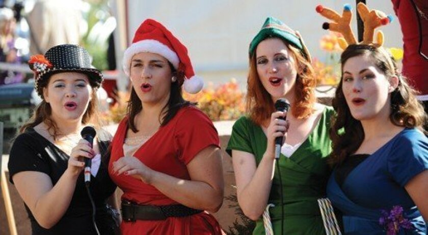 The Hep Kittens entertained with holiday music. Photo: Jon Clark
