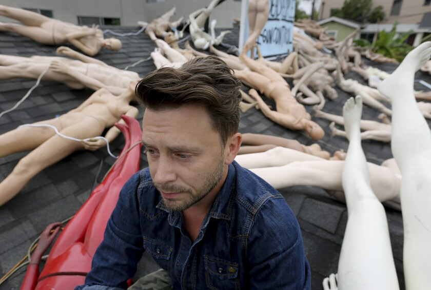 Artist ChadMichael Morrisette sits on the roof of his West Hollywood home where he has placed 50 mannequins, as a way of dealing with his grief and expressing his feelings over the mass killing in Orlando.