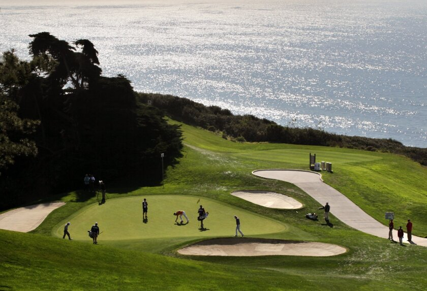 Day 2 of Farmers Insurance Open at Torrey Pines- The shines on the ocean as Brandt Snedeker's group plays hole 6 of the North Course.