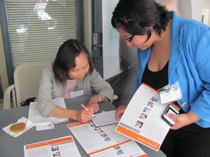 Li-Huey Wu of CareFusion assists a student.