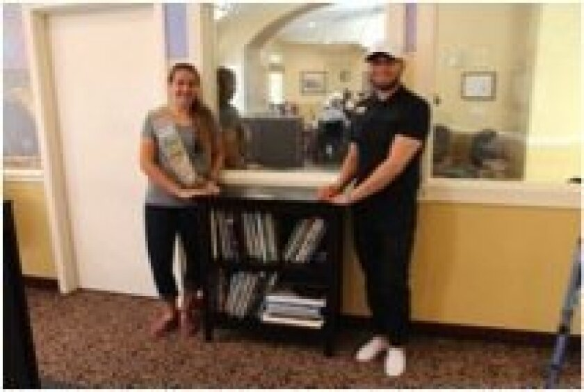 Jennifer DeSantis built two bookcases for a memory-care senior facility and stocked them with books that had lots of appealing photos and illustrations. Courtesy photo