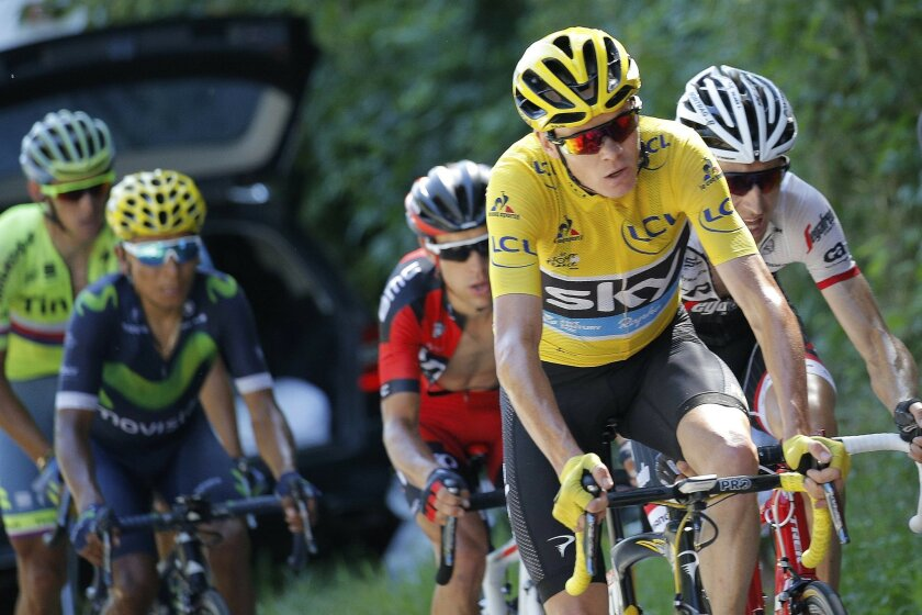 Britain's Chris Froome, wearing the overall leader's yellow jersey, Australia's Richie Porte, in red, and Netherlands' Bauke Mollema, right, break away from Colombia's Nairo Quintana, rear, during the seventeenth stage of the Tour de France cycling race over 184.5 kilometers (114.3 miles) with start in Bern and finish in Finhaut-Emosson, Switzerland, Wednesday, July 20, 2016. (AP Photo/Christophe Ena)