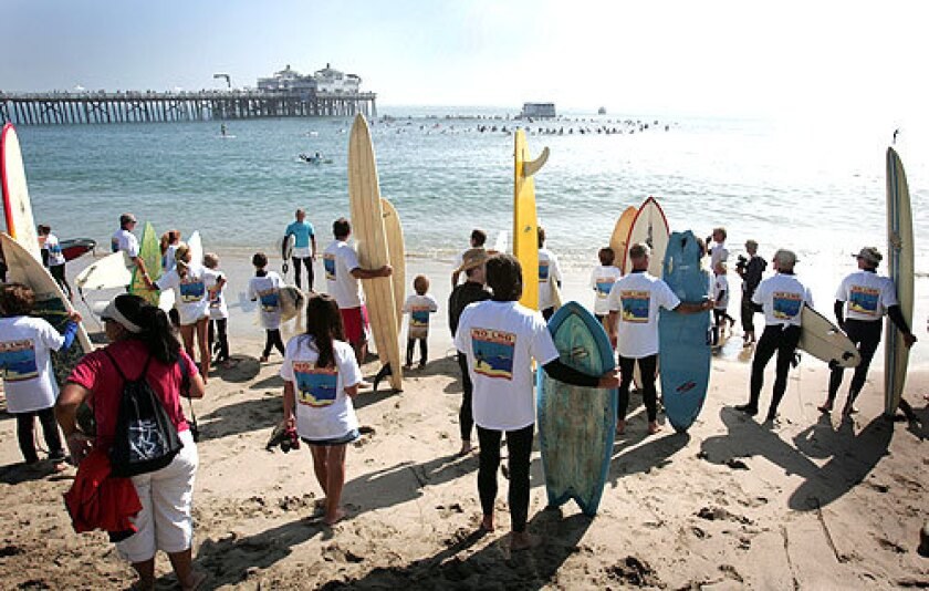 Ready to Get Wet: Demonstrators wait for their colors to be called before joining the protest circle off the Malibu Pier. Actress Daryl Hannah was among those who paddled out.