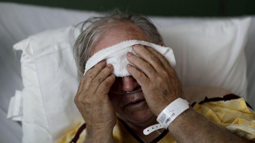 Henry Beverly, 73, battles the flu at Upson Regional Medical Center in Thomaston, Ga., in February. UC San Diego scientists have discovered a potential universal flu drug.
