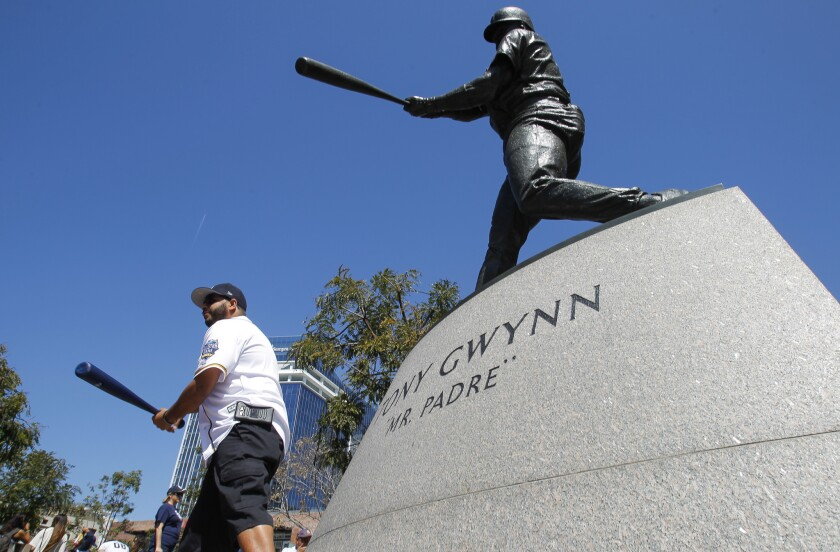 SAN DIEGO, April 1, 2017   Marco Tapia holds his bat for a picture while next to the statue of Tony