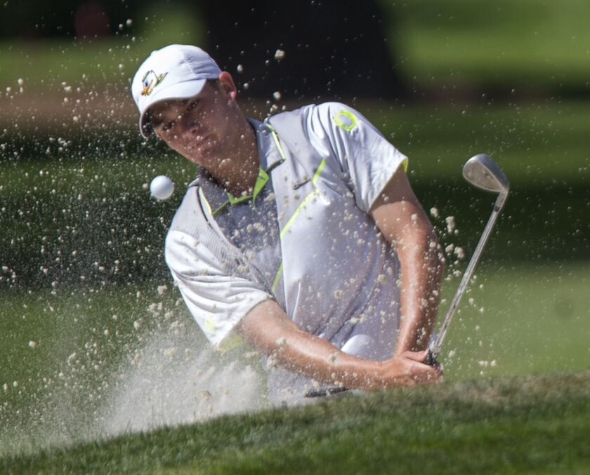 Oregon's Aaron Wise hits out of a bunker during his semifinal against Illinois' Dylan Meyer at the the NCAA men's golf championships at Eugene Country Club in Eugene, Ore., on Tuesday, May 31, 2016. (Andy Nelson/The Register-Guard via AP)