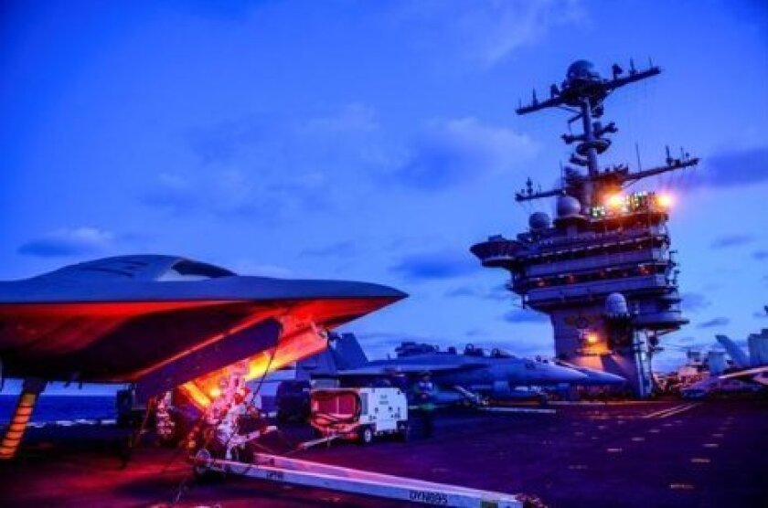 Northrop's X-47B unmanned combat air system demonstrator went through taxi tests on the carrier Truman last December.