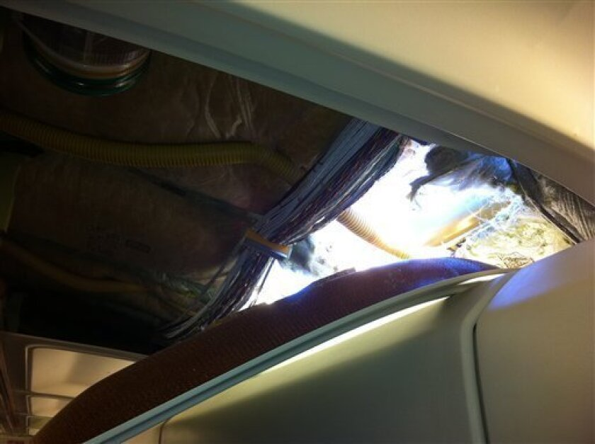 In this photo provided by passenger Christine Ziegler, shows an apparent hole in the cabin on a Southwest Airlines aircraft Friday, April 1, 2011 in Yuma, Ariz. Authorities say the flight from Phoenix to Sacramento, Calif., was diverted to Yuma due to rapid decompression in the plane. FAA spokesman Ian Gregor says the cause of the decompression isn't immediately known. But passengers aboard the plane say there was a hole in the cabin and that forced an emergency landing. (AP photo/Christine Ziegler) NO SALES