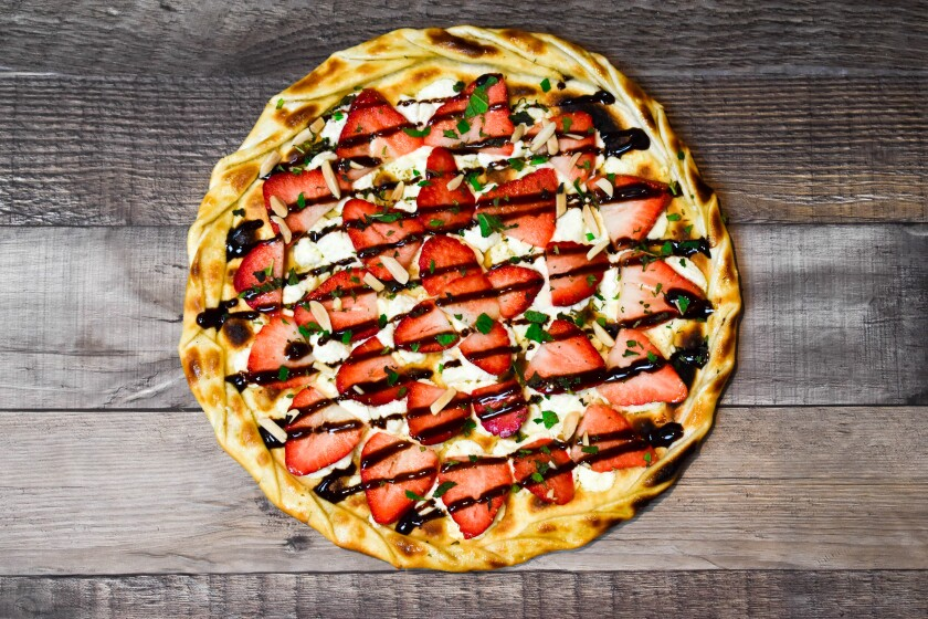 Sammy's Lover's Delight dessert pizza is made with goat cheese, chili oil, fresh strawberries, almonds, fresh basil and chocolate drizzle on a crispy, French-style crust. The special is available through the end of the month.