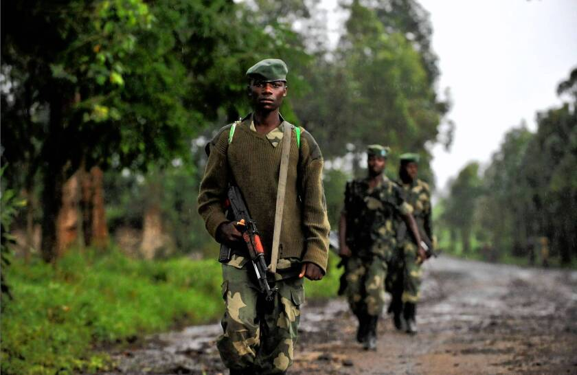 M23 soldiers patrol in Rangira, near Rutshuru, in eastern Congo. United Nations experts say neighboring Rwanda armed and commanded the group, which rebelled against the Congolese army in April.