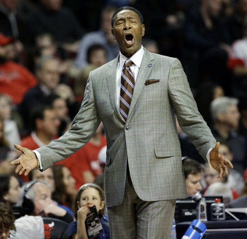 Minnesota Timberwolves head coach Sam Mitchell reacts to a call during the first half of an NBA basketball game against the Chicago Bulls on Saturday, Nov. 7, 2015, in Chicago. (AP Photo/Nam Y. Huh)