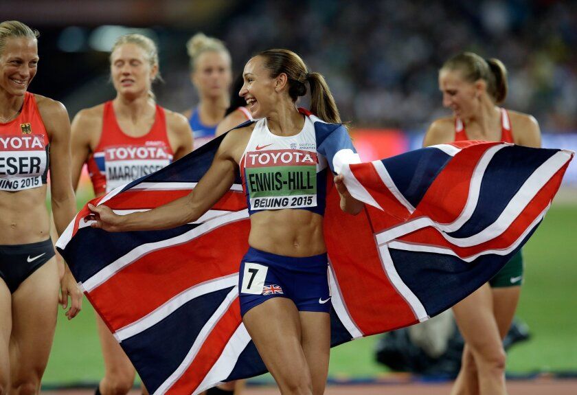 Britain's Jessica Ennis-Hill celebrates with her country's flag after finishing the women's 800m race of the heptathlon at the World Athletics Championships at the Bird's Nest stadium in Beijing, Sunday, Aug. 23, 2015. (AP Photo/Kin Cheung)