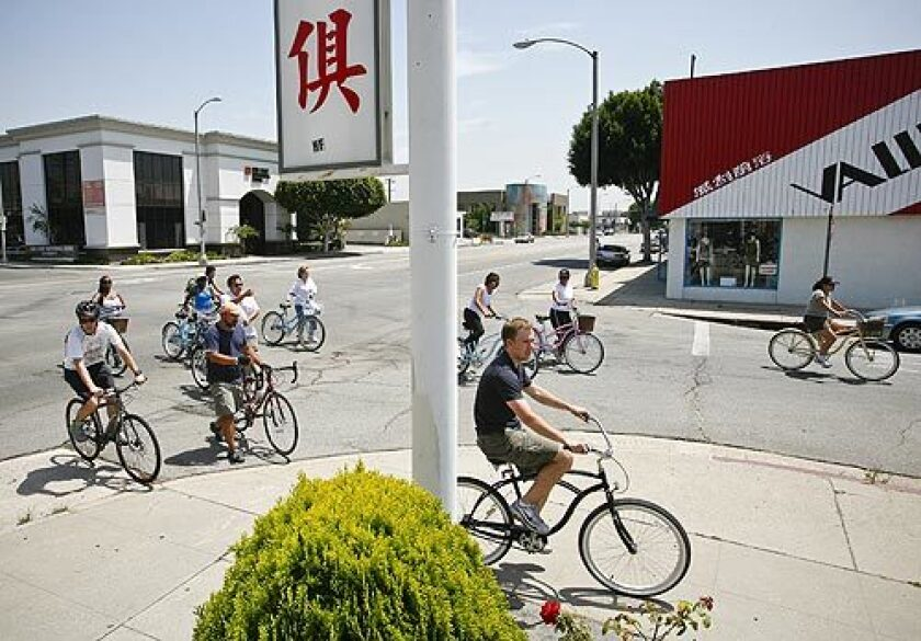 Bicyclists cruise the streets during a ride to a dim sum restaurant in Alhambra. Flying Pigeon LA bike shop, owned by brothers Adam and Josef Bray-Ali, sponsors the once-a-month ride to different restaurants.