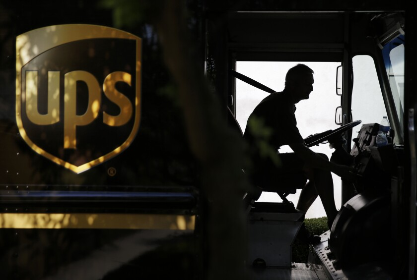 """UPS Store Inc. said more than 100,000 customer transactions could have been exposed by a """"limited malware intrusion"""" from January to this month. Above, a UPS driver in Cumming, Ga."""