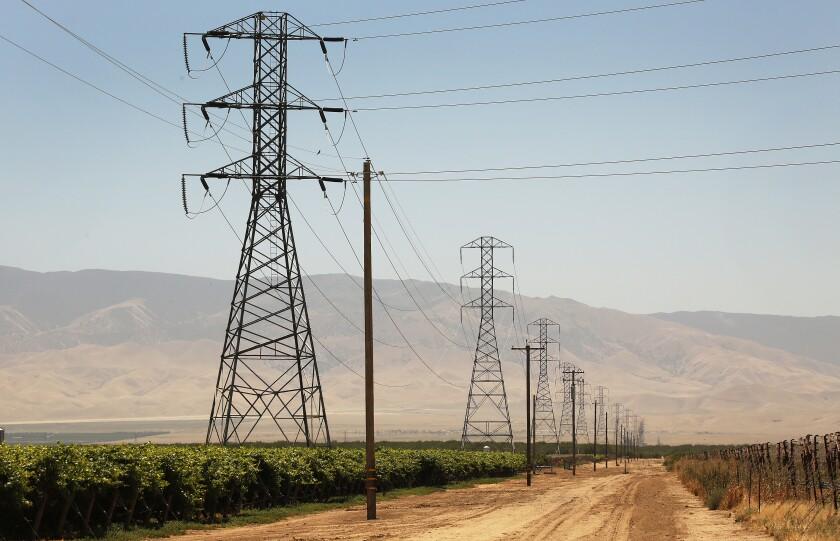 Power lines run through farmland in Kern County