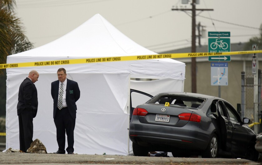Los Angeles sheriff's officials investigate a shooting at Rosecrans Avenue and Crenshaw Boulevard in Hawthorne on Sunday.