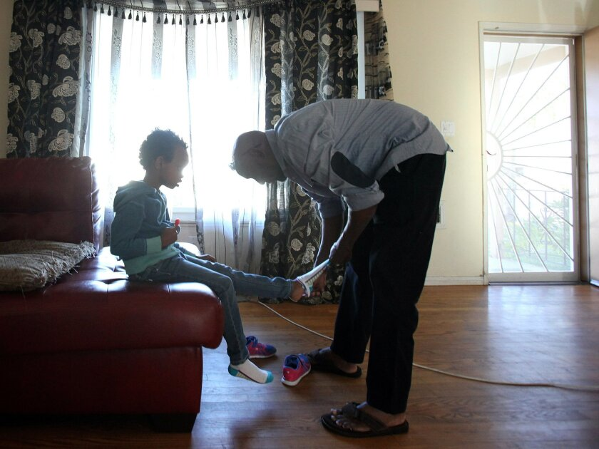 On Wednesday, Liban Ali, right, will receive an award for his efforts to help Somali parents of autistic children. He has first-hand knowlege of what's needed -- two of his five children, including 5-year-old Suhaan Abdi, left, are autistic.