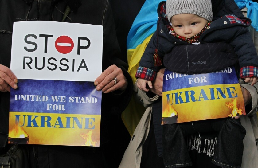 Pro-Ukrainian supporters demonstrate Thursday outside a gathering of the European Peoples Party at the Dublin Convention Center in Dublin, Ireland.