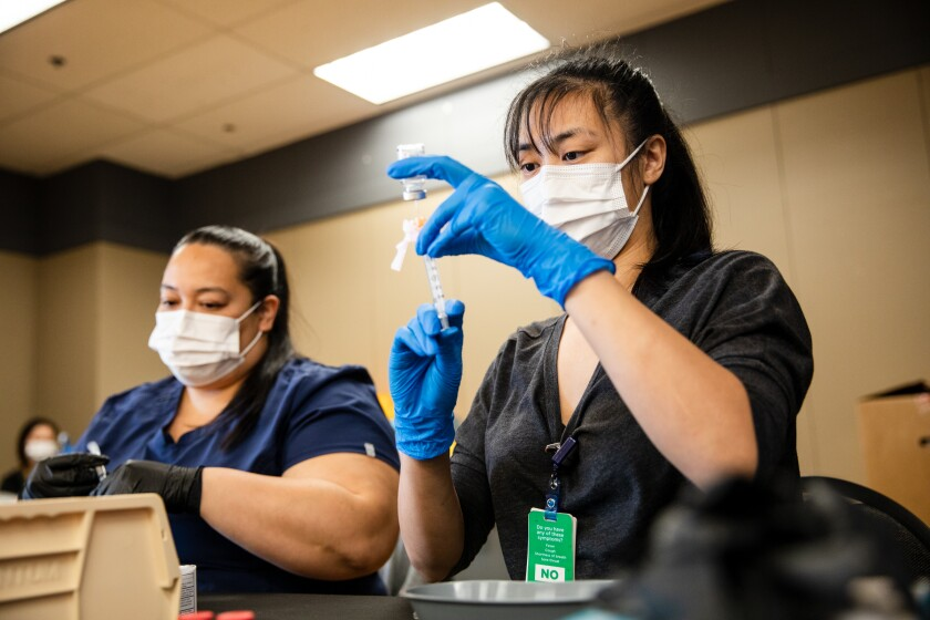 Pharmacy workers prepare Moderna vaccines on March 29.