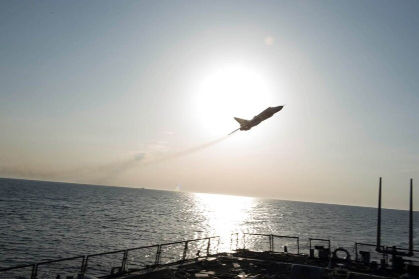 A Russian Sukhoi Su-24 attack aircraft makes a low altitude pass by USS Donald Cook on April 12, 2016.