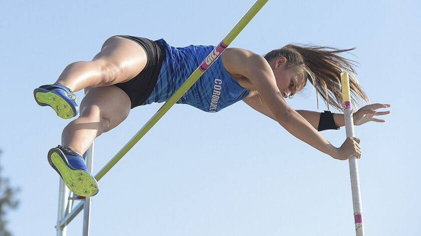 Morgan Simon of Corona del Mar clears the bar as she competes in the pole vault during the 51st Annu