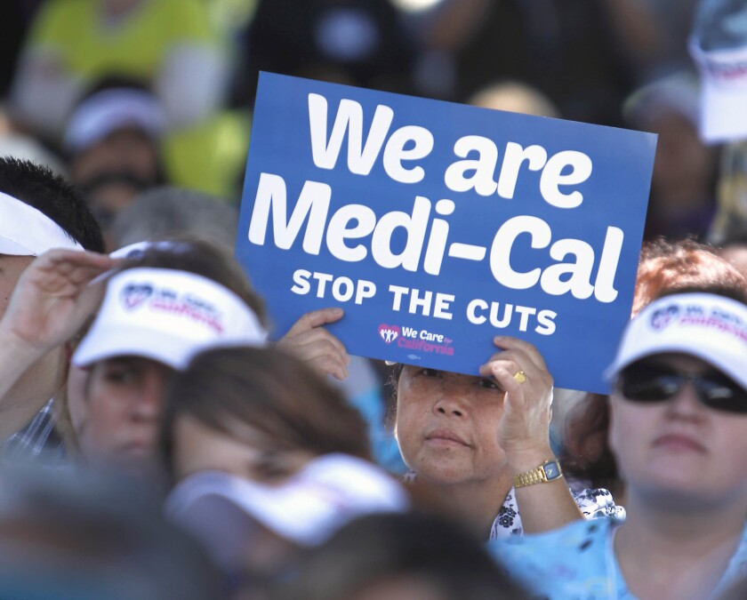 Demonstrators representing doctors, hospitals and unionized healthcare workers rallied against a 10% cut in the amount the state pays for Medi-Cal reimbursements, at the Capitol in Sacramento.