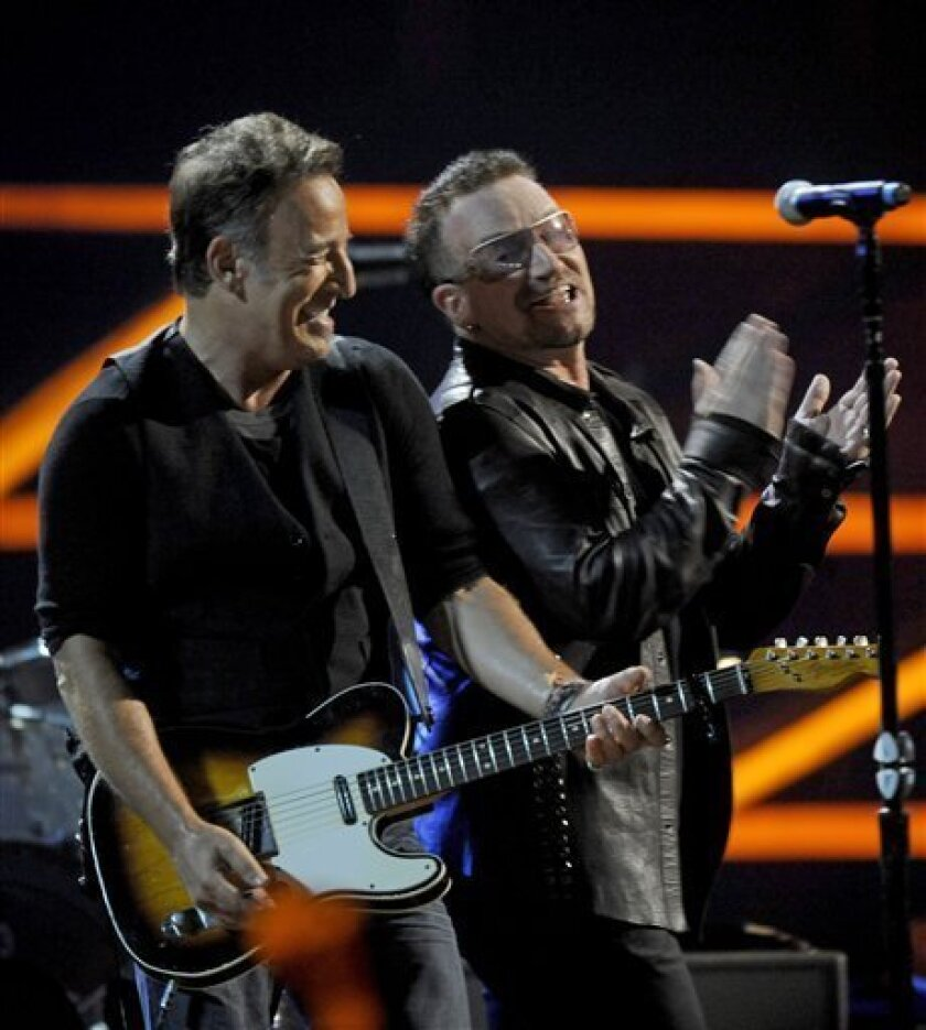U2's Bono, right, and Bruce Springsteen perform at the 25th Anniversary Rock & Roll Hall of Fame concert at Madison Square Garden, Friday, Oct. 30, 2009 in New York. (AP Photo/Henny Ray Abrams)