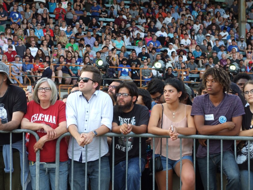A crowd of supporters listen to Bernie Sanders speak at a rally in Bakersfield.
