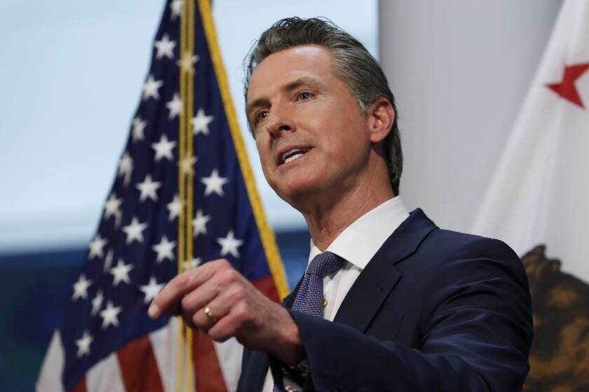 Gov. Gavin Newsom updates the state's response to the coronavirus at the Governor's Office of Emergency Services in Rancho Cordova, Calif., Monday, March 23, 2020. Newsom announced the closure of all state parking lots to discourage people from congregating at the state beaches and other public spaces during the coronavirus outbreak.